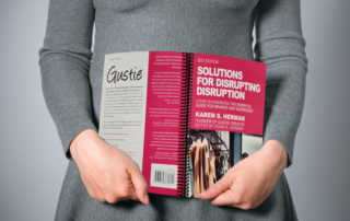Solutions for Disrupting Disruption, COVID-19 Handbook, Held by Female Reader